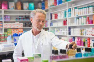 Senior pharmacist looking a medicine in the pharmacy